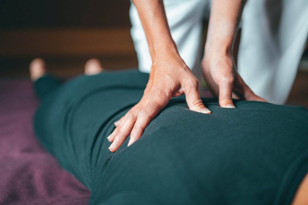 close up image of a person giving a massage